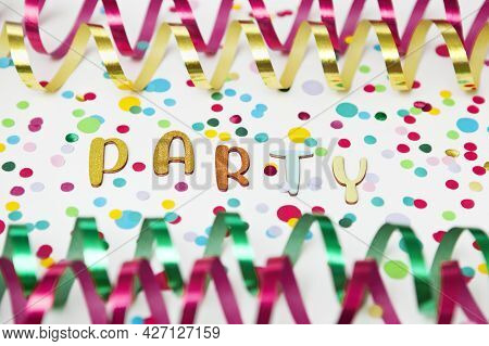 Colorful Photo With Letters Saying Party, Paper Streamers An Confetti On White Background.