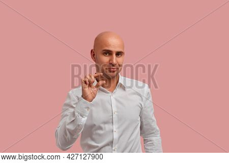 Few Inches, Centimeter. Funny Bald Man With Bristle In White Shirt, Showing A Little Bit Gesture, As