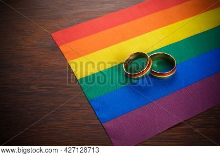 Love Wins Concept With A Multicolored Wedding Rings. Equality And Love Protection