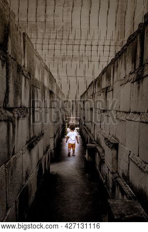 Caucasian Young Kid Walking With Labyrinth Perspective. Conceptual Image For Dangerous Situation Dur