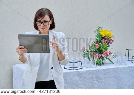 Organization Of Parties, Ceremonies, Professional Woman Organizer With Digital Tablet