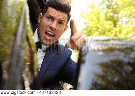 Emotional Man Yelling In Car, View From Outside. Aggressive Driving Behavior