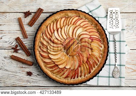 Delicious Homemade Apple Tart, Cinnamon, Anise And Cake Shovel On White Wooden Table, Flat Lay