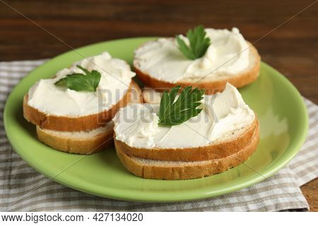 Bread With Cream Cheese And Parsley On Plate