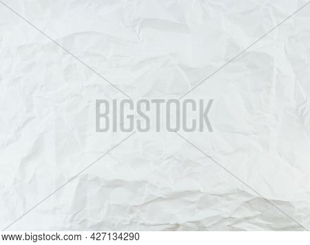 Crumpled White Paper Sheet Texture With Empty Space.