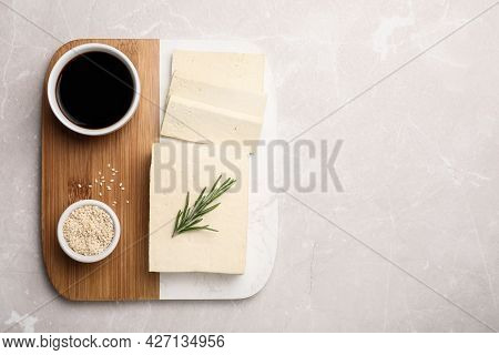 Delicious Tofu With Rosemary, Sesame Seeds And Soy Sauce On Light Table, Top View. Space For Text