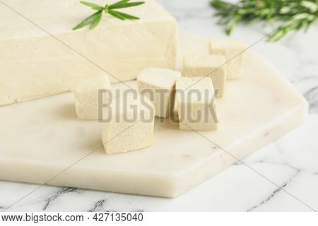 Delicious Tofu With Rosemary On White Marble Table, Closeup
