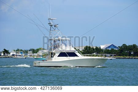 Bethany Beach, Delaware, U.s.a - July 11, 2021 - A Fishing Boat Passing The Water Near Indian River