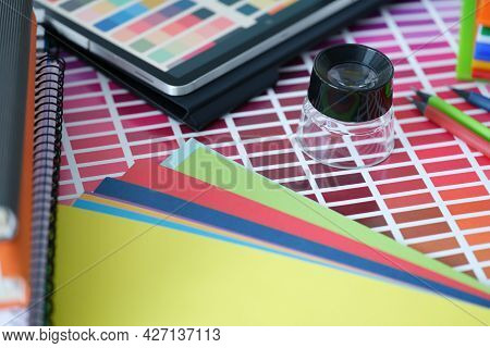 Color Palette With Colored Paper And Tablet With Color Samples Lie On Table
