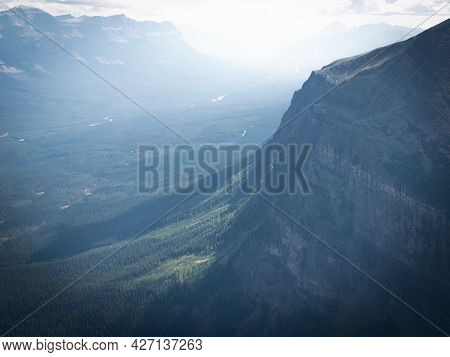 Beautiful Alpine Valley Scene With Hazy Light, Shot At Mount St. Piran Summit, Banff National Park,