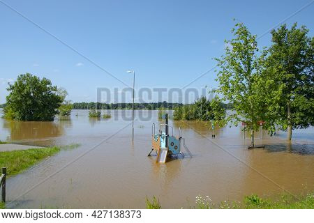 Flooded Dutch Polder Area Next To A Dike Overgrown With Grass. Flood In Limburg In July 2021.