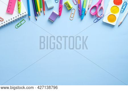 School Stationery Frame Border Top View. Back To School Concept On Blue Background. Flat Lay, View F
