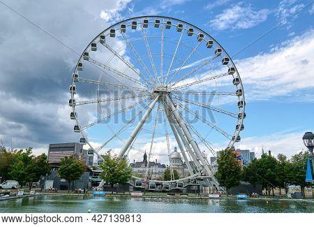 Canada, Montreal - July 11, 2021: Scenic View Of Ferris Wheel La Grande Roue De Montreal In Old Port
