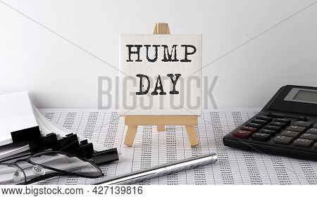 Text Hump Day On Easel With Office Tools And Paper.top View. Business