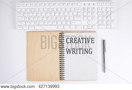 Creative Writing Text On Notebook With Keyboard On White Background
