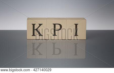 Kpi Concept, Wooden Word Block On Grey Background