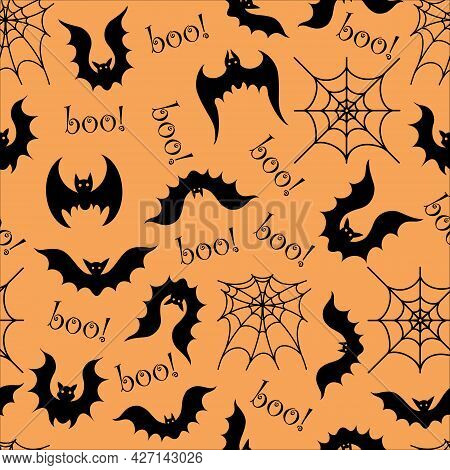 Seamless Vector Pattern With Halloween Elements. Silhouette Of A Bat And Spider Web On An Orange Bac
