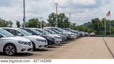 Wilkins Township, Pennsylvania, Usa July 18, 2021 Brand New Nissan Automobiles Together In A Parking