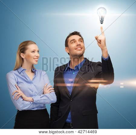 bright picture of man and woman with light bulb