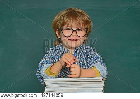 School Kids Against Green Chalkboard. Elementary School And Education. Talented Child. First School