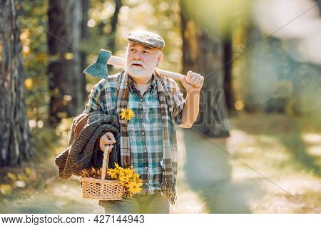 Bearded Man Relax In Forest. Smiling Old Forester With Axe And Flowers. Happy Man With Beard And Mus