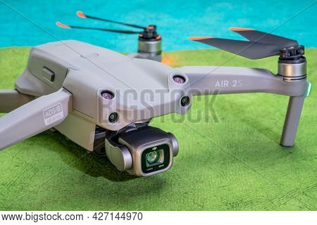 Fort Collins, CO, USA - July 12, 2021: New DJI Mavic Air 2s against abstract paper landscape - an advanced prosumer folding lightweight drone.