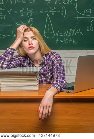 Negative Facial Expression. Tired Student Learning At Home. Young College Student At Hard Exam Prepa