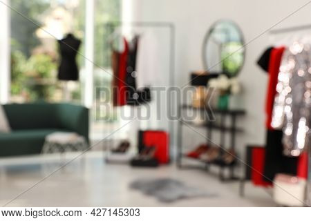 Blurred View Of Modern Dressing Room Interior With Stylish Furniture