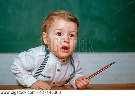 Little Preschool At School Lesson. Home Study. Kid Gets Ready For School. Cute Little Preschool Kid