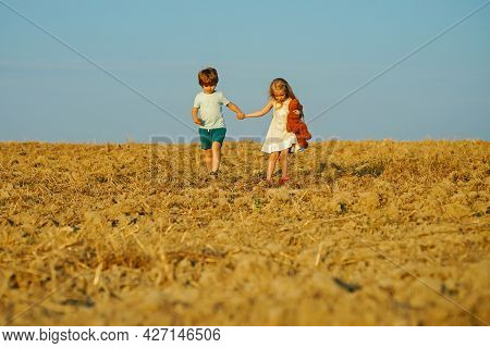 Beautiful Fun Day For Cute Friends In Nature. Children Has Summer Joy. Children Play Outdoors. While