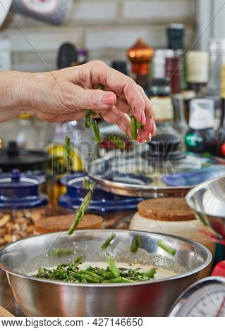 Chef Dips Asparagus Into The Crockery To Make Baked Goods With Asparagus And Peas. Step By Step Reci