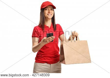 Fast food delivery girl with a paper bag and a mobile phone isolated on white background