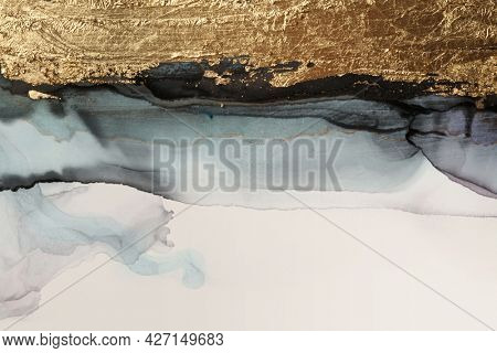 Art Abstract  watercolor and acrylic marble flow blot painting. Black and gold Color canvas texture beige long horizontal background. Alcohol ink.