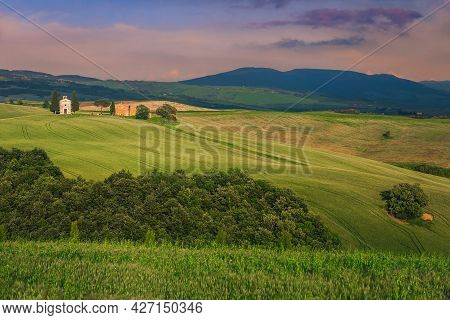 Majestic Tuscan Rural Scenery At Sunset With Grain Fields On The Slope And Vitaleta Chapel, Tuscany,