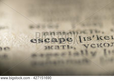 Focus On Escape Word Printed In Vintage Dictionary