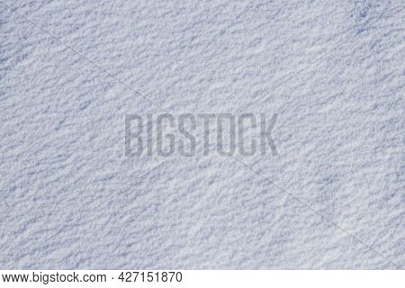Uniform Snow Cover. Snow Texture On A Flat Plot Of Land