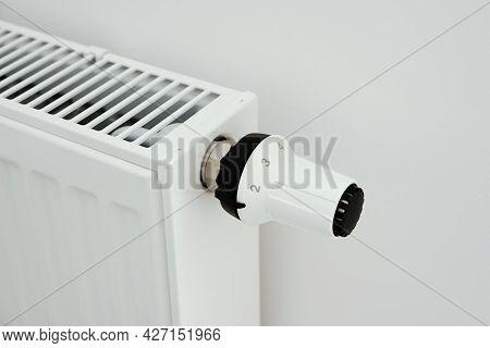 Heat Radiator Knob. Adjusting Temperature On Heating Radiator