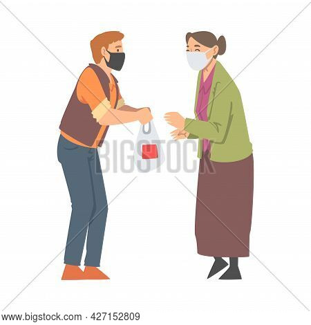 Man Volunteer In Face Mask Giving Food To Senior Woman Engaged In Charity Activity Donating It To Ne