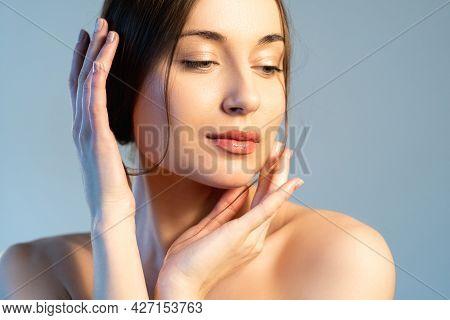Facial Skin Care. Elegant Woman. Spa Beauty. Salon Procedure. Peaceful Gorgeous Female With Nude Mak