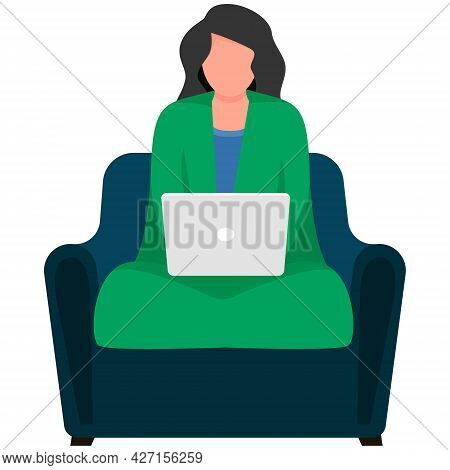 A Woman In A Blanket Sits On An Armchair And Works At A Laptop