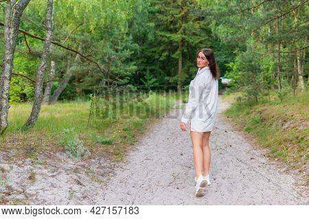 Young Pretty Woman Walking In A Forest, Sunny Summer Day,freedom.young Beautiful Woman Walking By A
