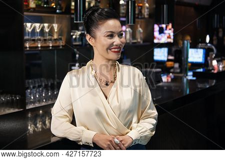 Attractive Elegant Woman Attending Cocktail Party At Restaurant