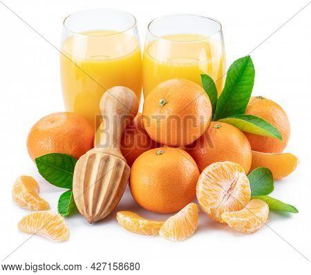 Orange tangerine fruits and two glasses of fresh tangerine juice isolated on white background.