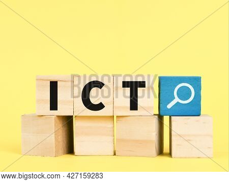 Letters Ict On Wooden Cubes Against Yellow Background. Technology Concept.