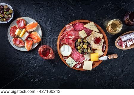 Charcuterie And Cheese Board, Overhead Flat Lay Composition With Copy Space On A Black Background. I