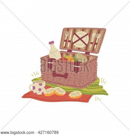 Wicker Picnic Basket On Tablecloth With Fresh Food For Lunch