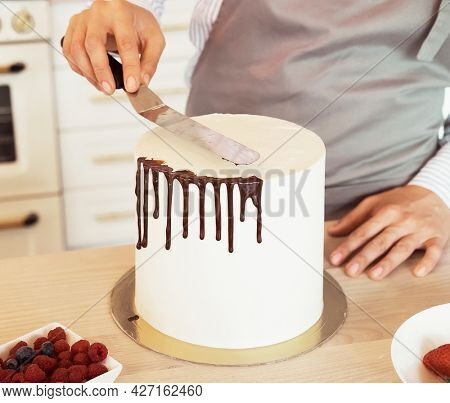 woman is engaged in cake decorating, small home business