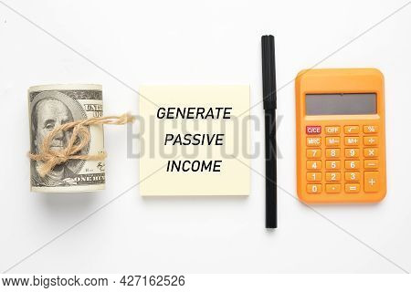 A Picture Of Notepad Written Generate Passive Income, Fake Money, Pen And Calculator