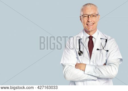 Cheerful male doctor in a white gown portrait