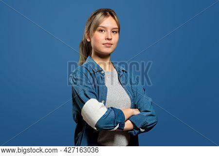 Female volunteer wearing a armband portrait